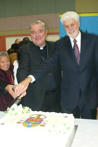 Archbishop of Winnipeg Richard Gagnon and Jubilee Chair John Stapleton cut the cake